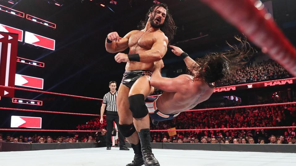 roman reigns fighting with drew mclyntre