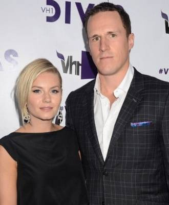 Elisha Cuthbert with her husband